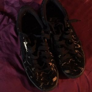 Black and Gold Pumas Size 7